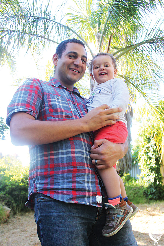 • Ayman Qwaider and his son Tamim. Photo by Stephen Pollock